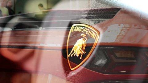 PRAGUE, CZECH REPUBLIC, CAR EXHIBITION - SEPTEMBER 27, 2014: detail of logo (wheel) - Lamborghini (interior) - backlight and side of car (mirror)- luxury fast car - Lamborghini - Aventador