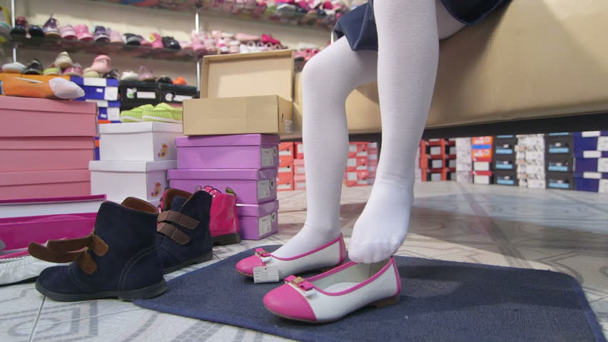 hd00 08Little girl trying on new white pink ballet flats in children shoe  ...