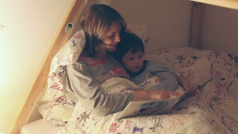 Mother and child, reading a book before bed time