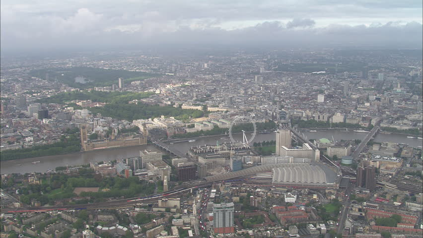 AERIAL United Kingdom-Track Across Central London 2006: shot across Thames to Parliament and St Jame's Park, includes Big Ben, London Eye, Hyde Park, Regents Park, London Imax, Royal Festival Hall