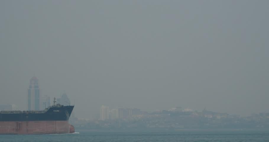 March 10, 2015:4k Huge container oil tanker ship on ocean,modern building background. gh2_10958_4k