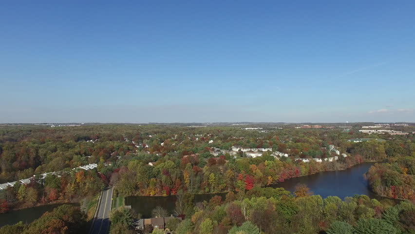 Germantown, Maryland Aerial Pull Back - Beautiful Trees and Suburbs in Fall Near Lake Churchill