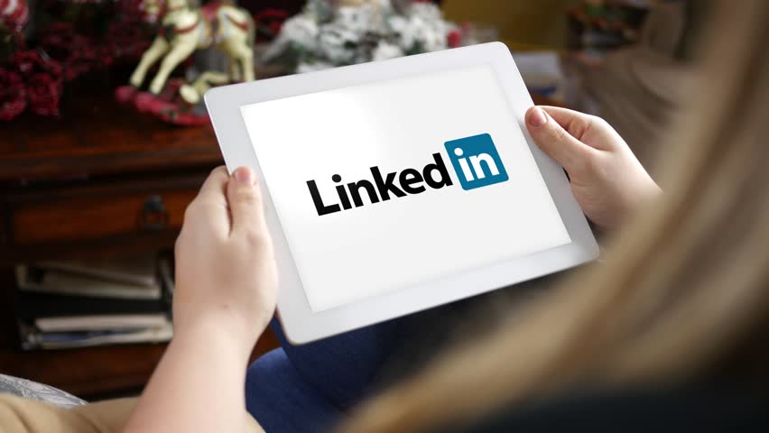Clarion, PA  - Jan 22 2017 - Woman looking at the Linkedin logo on her tablet