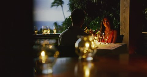 Couple enjoying romantic candle light dinner