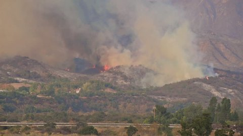 CIRCA 2010s - The Thomas wildfire fire burns behind expensive homes in Ventura County Southern California.
