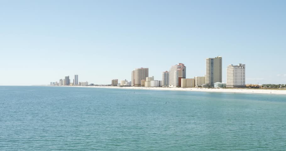 Panoramic view of the seashore with modern luxury residential buildings and hotels along the coastline against clear blue sky in a beautiful sunny day