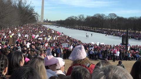 WASHINGTON, DC - JAN 20, 2018; Massive crowds around frozen Reflecting Pool at Lincoln Memorial rally during 2018 Women's March and Voter rally.
