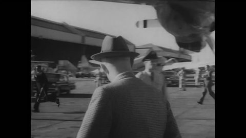 CIRCA 1957 - President Eisenhower is filmed getting off the USAF plane Columbine at a Washington DC airport.