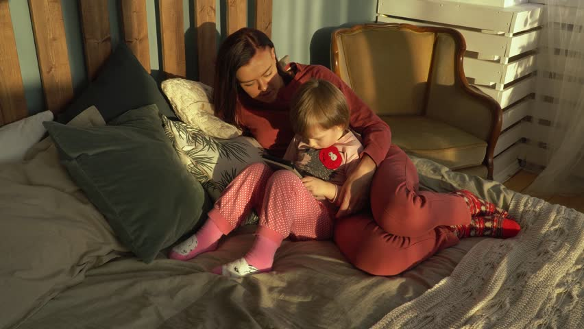 Mother spends time with her little daughter at home