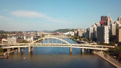 PITTSBURGH, PENNSYLVANIA - CIRCA 2010s - Beautiful aerial over bridges on the Monongahela River to Pittsburgh, Pennsylvania downtown skyline.