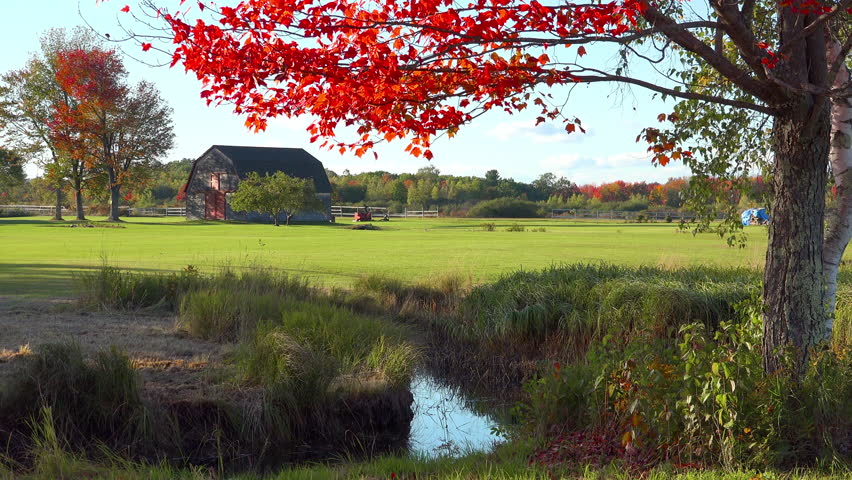 MAINE - CIRCA 2010s - A pretty old barn and farmhouse in fall in rural Maine.