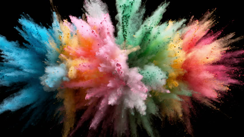 Colorful powder/particles fly after being exploded against black background. Shot with high speed camera, phantom flex 4K. Slow Motion.