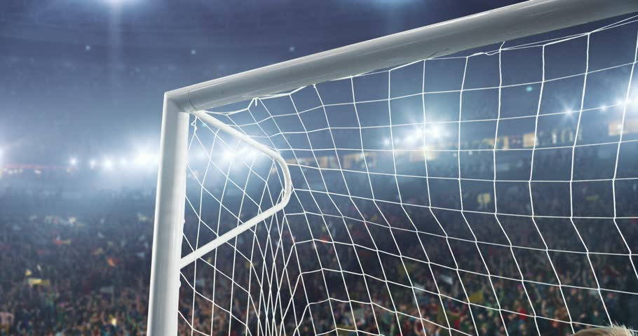 Soccer goalkeeper jumps and catches ball on a professional soccer stadium. Stadium and crowd is made in 3D and animated