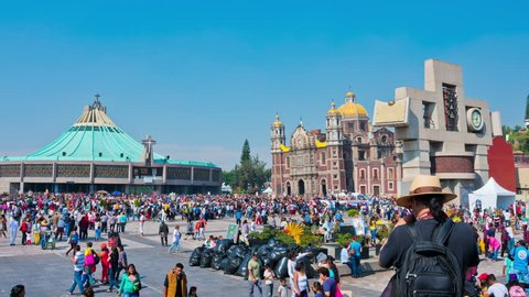 Mexico City - December 12, 2016: Pilgrims celebrate the Day of the Virgin of Guadalupe with a mass ceremony in her honor in Basilica of Our Lady of Guadalupe. Time lapse 4k