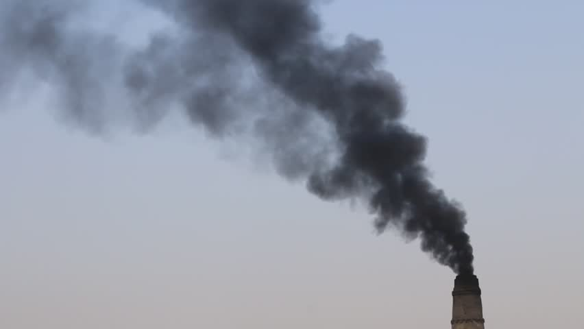 Heavy poisonous smoke coming from a brick factory chimney polluting environment. | Shutterstock HD Video #1006799494