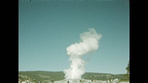 1940s: Mountains. Steam rises off hot springs. Geyser erupts.