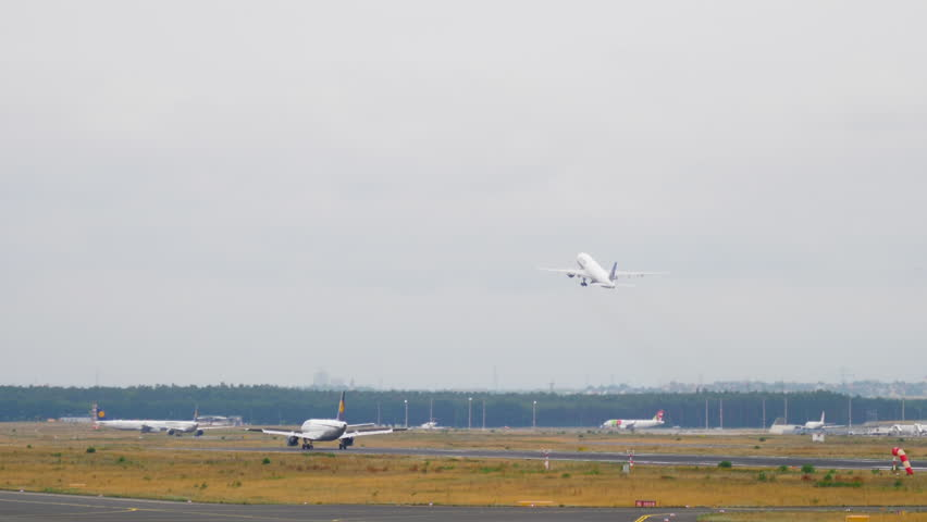 FRANKFURT AM MAIN, GERMANY - JULY 17, 2017: Lufthansa Airbus 320 landing, United Boeing 777 take-off. Fraport, Frankfurt Germany