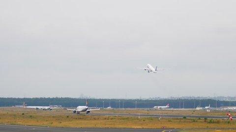 FRANKFURT AM MAIN, GERMANY - JULY 17, 2017: Lufthansa Airbus 320 landing, United Boeing 777 take-off. Fraport, Frankfurt Germany