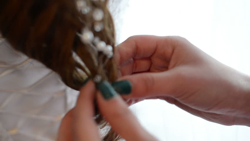 Hair stylist working on a bride's hair