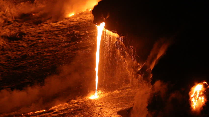 Lava running in the ocean from volcanic lava eruption on Big Island Hawaii. Lava stream flowing in Pacific Ocean from Kilauea volcano by Hawaii volcanoes national park, USA. Night shot 59.94 FPS. | Shutterstock HD Video #1006904404