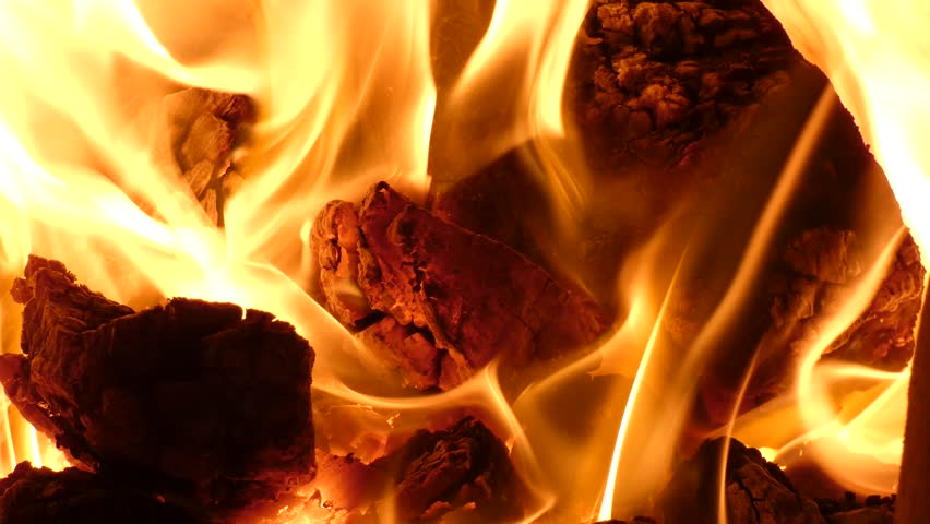 Fireplace - Red Hot Fire Flames of Burning Coal in the Stove. Radiant heating is warming interior of a house.