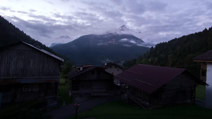 TIMELAPSE 4k clouds over mountains revolving around the wonderful peak Civetta in Dolomiti wide wiew (near Pelmo, Agordo, Alleghe, Falcade)