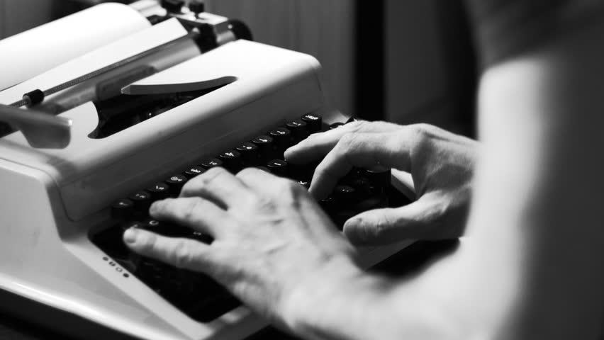 Hands typing a film script or a book on a vintage typewriter, 4k black and white video  | Shutterstock HD Video #1006950814