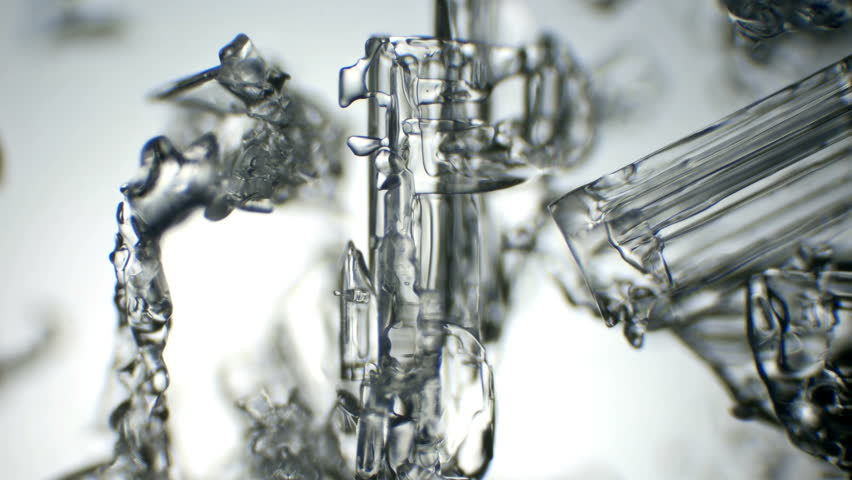 The ice crystals melting,photographed under a microscope | Shutterstock HD Video #1006954984