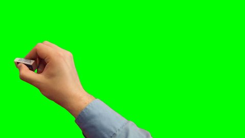 Hand Writes and Erases. Green screen - Chroma key. With alpha matte.