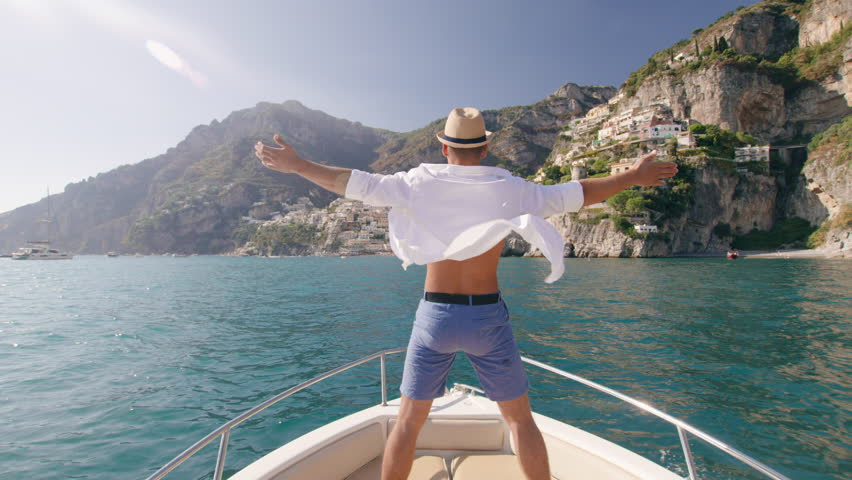 Handsome Successful Man Raising Arms In The Front Of Boat Luxury Lifestyle Holiday In Europe Yachting Slow Motion Shot Red Epic 8k | Shutterstock HD Video #1006991434
