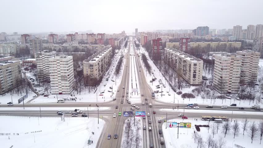 SAINT PETERSBURG, RUSSIA - JANUARY 18, 2018: Straight city streets intersection, aerial shot in winter day, north sleeping district of city. Crossing of large Svetlanovskiy and Lunacharsky avenue