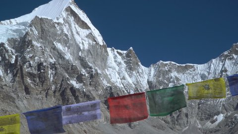 Prayer flags against the background of the Everest. Himalayas. Nepal. 4K