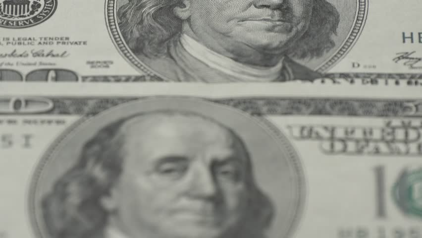 One hundred dollar bills close-up - 2. Macro photography of banknotes. Portrait of Benjamin Franklin.   Shutterstock HD Video #1007114794