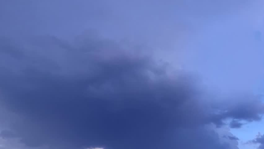 Storm clouds move, fly, fast motion timelapse background. 3840x2160 4K dark dramatic storm clouds time lapse. Grey, gray, blue, black clouds moving sky. Cloudy stormy dramatic rain weather. Storm UHD.