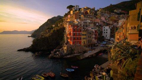 Riomaggiore, Cinque Terre, Italy at Sunset - Riomaggiore is a traditional fishing village in La Spezia, situated in coastline of Liguria of Italy. Riomaggiore is one of Cinque Terre travel village.