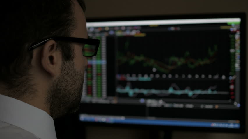 Businessman sitting and using computer showing trading graph stock exchange trading graph screen background, Business financial and forex concept. PC monitor showing blur  feed page . | Shutterstock HD Video #1007193844