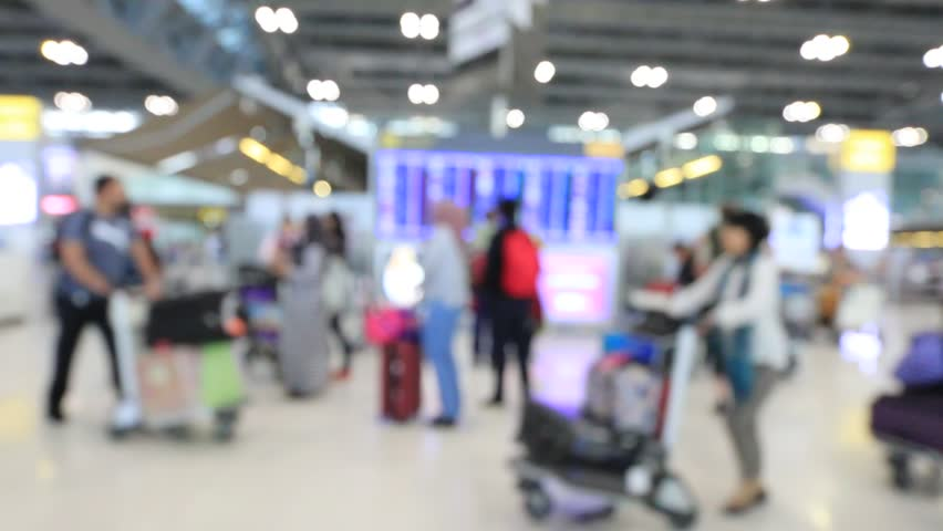 Abstract blur view of commuter crowd of people and passenger walk in the airport terminal, Blurred busy Airport Terminal footage concept.  | Shutterstock HD Video #1007215504