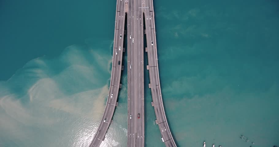 An aerial view of Penang Bridge . Top view panning to front view