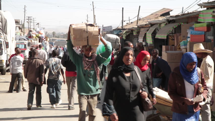 ETHIOPIA - CIRCA -2011: Africans, Carrying goods on the head, The Mercato, Ethiopia, Addis Ababa, Africa