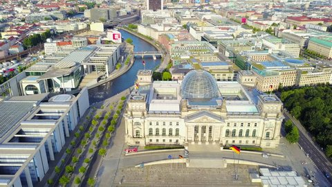 Germany Berlin Aerial v21 Birdseye flying low around Reichstag building sunset cityscape 8/17
