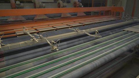 Production of ceramics, automatic machine produces ceramic tiles, conveyor.