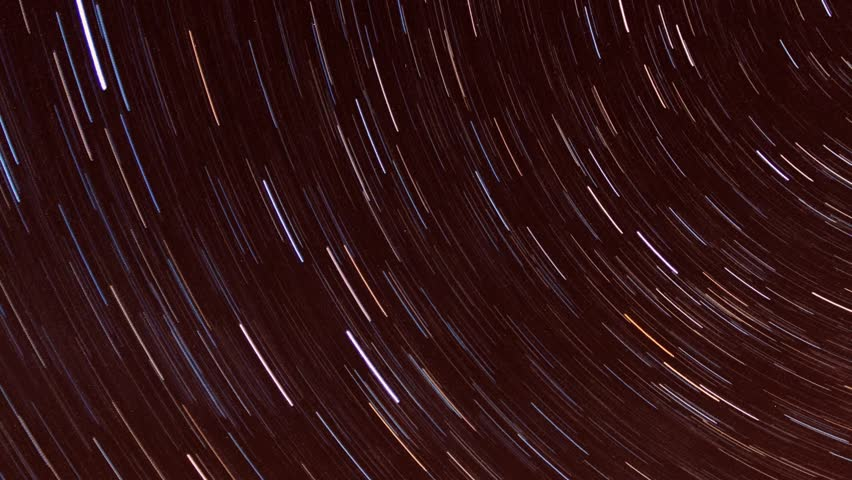 STAR TRAIL NATURE DARK NIGHT SKY, METEOR SHOWER IN BEAUTYFUL CLEAR HORIZON. Star Trail Galaxy Spins Behind Joshua Tree in Stunning Night Desert Timelapse, Astrophotography time lapse. ULTRA HD. 4K.
