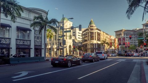 BEVERLY HILLS - January 2018: Traffic at Rodeo Drive at sunset. 4K UHD Hyperlapse Timelapse.