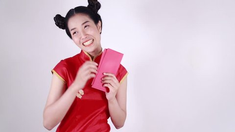 woman wear cheongsam and counting red envelope in concept of happy chinese new year