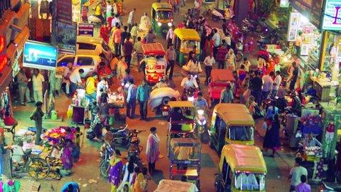 DELHI, INDIA - October 2017: Night view of Main bazar street in Delhi, India. Steadicam shot.