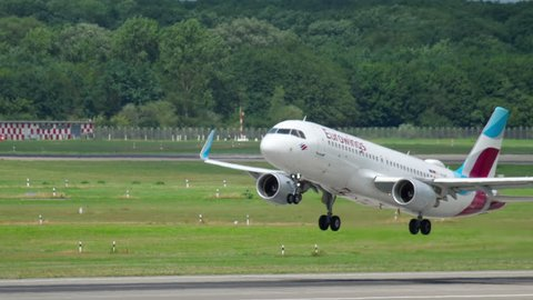 DUSSELDORF, GERMANY - JULY 21, 2017: Eurowings Airbus 320 D-AEWK take-off and climb. Dusseldorf airport