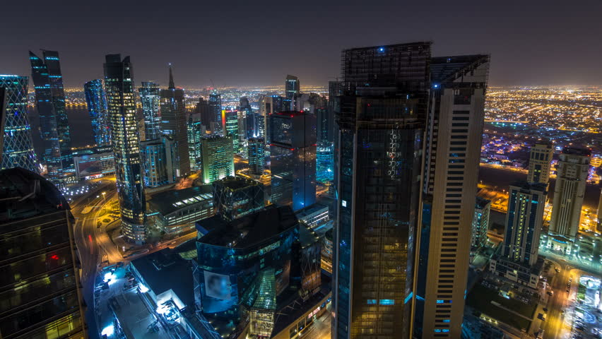 The skyline of the West Bay area from top in Doha timelapse, Qatar. Illuminated modern skyscrapers aerial view from rooftop at night #1007434654