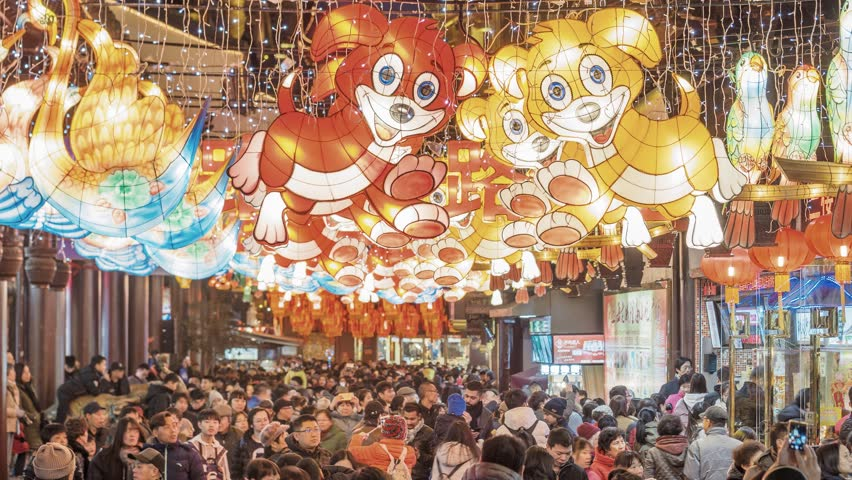Shanghai, China - Feb. 12, 2018: Lantern Festival in the Chinese New Year( Dog year), high angle view of colorful lanterns and crowded people in Yuyuan Garden at night, 4K version time lapse video.