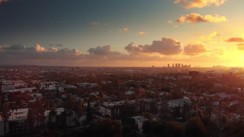 Aerial panorama revealing epic city of Los Angeles cityscape skyline at sunset. 4K UHD. | Shutterstock HD Video #1007443222