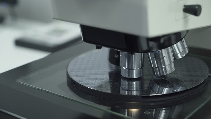Science, view of microscope and silicon wafer, innovative production.